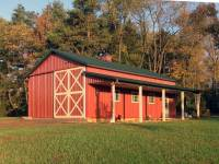 25x40x12 post-frame garage and ag building with 8' porch in Valencia, PA - end view in sunshine
