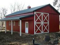25x40x12 post-frame garage and ag building with 8' porch in Valencia, PA