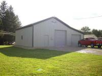 28x36x12 post-frame garage with 12' shed in Cooperstown, PA